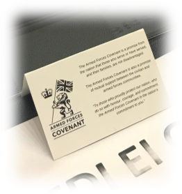 The Armed Forces Covenant Logo on a card at a project