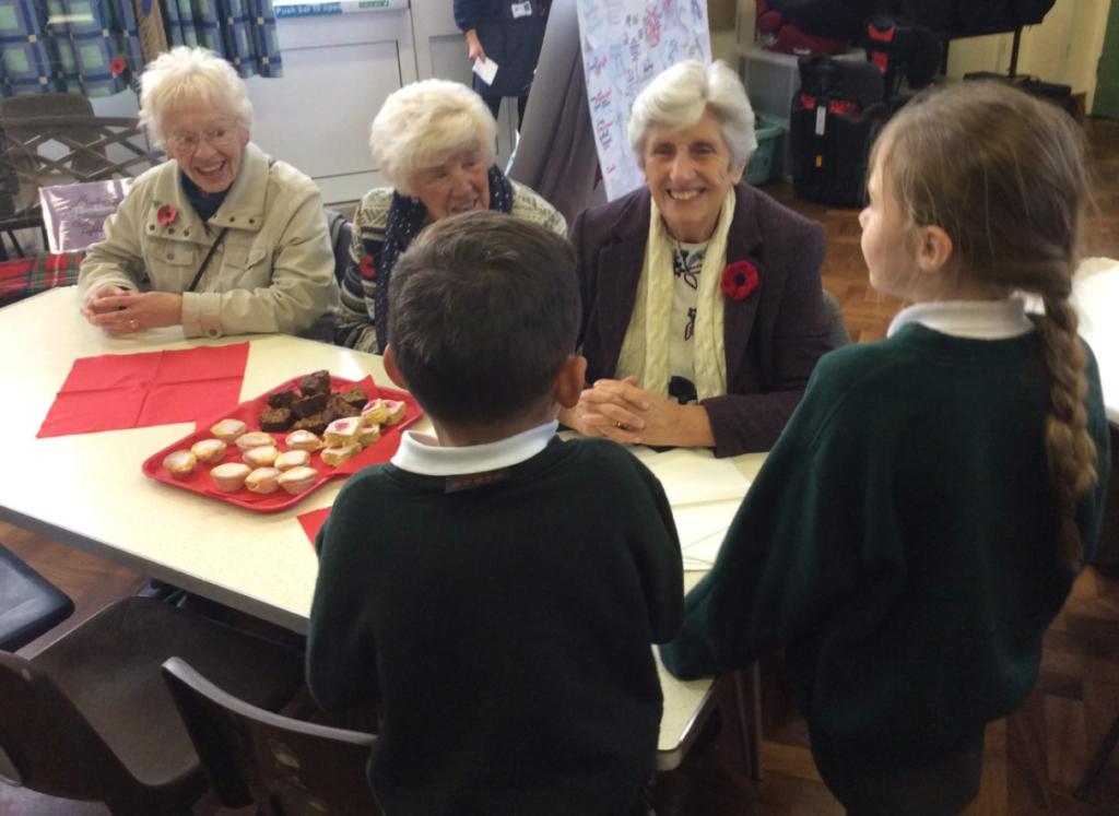 School children meeting veterans