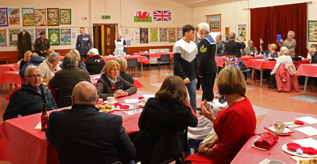 People at Abberrfraw Village Hall taking part in a community tea party