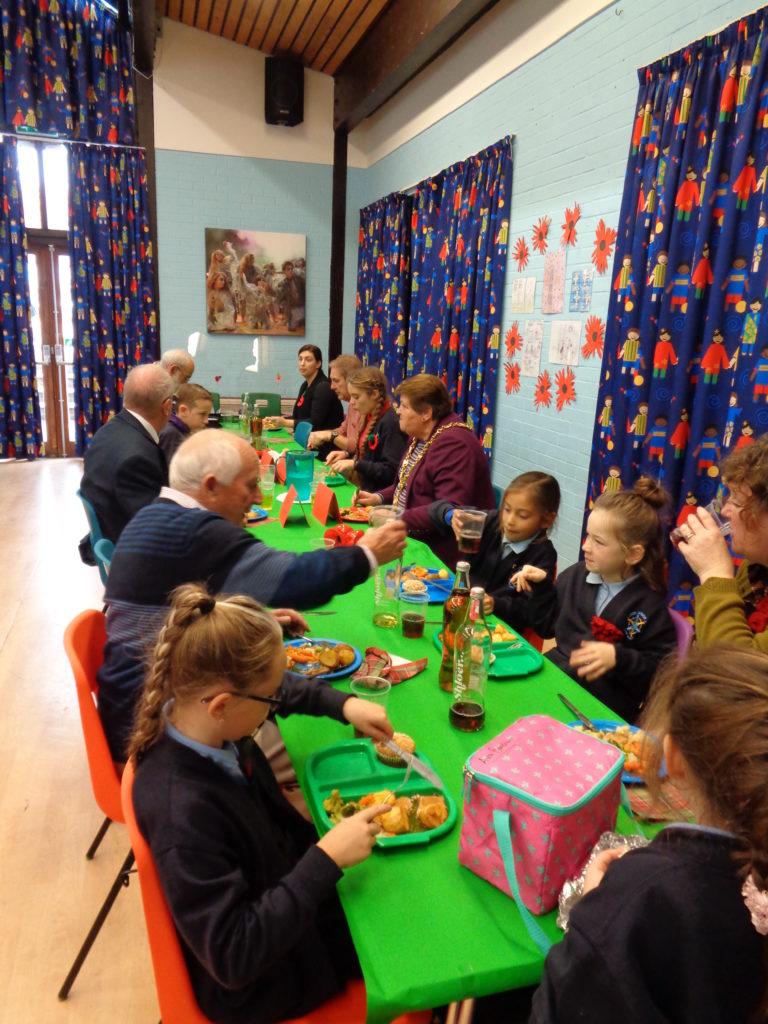 Schoolchildren and veterans taking part in craft activities together
