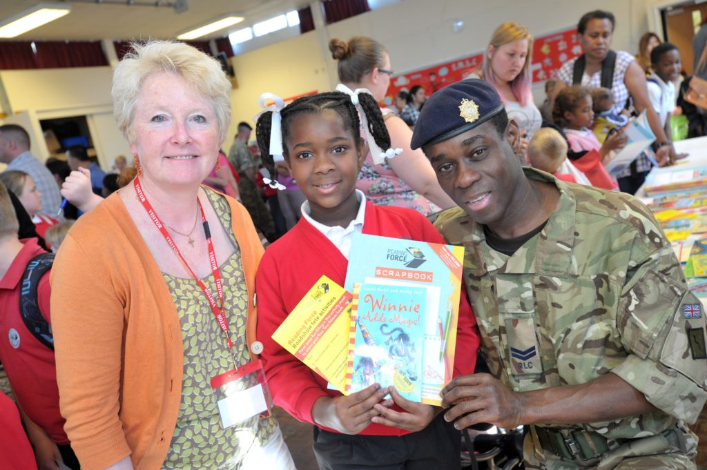 A picture of an Armed Forces family accessing books from Reading Force