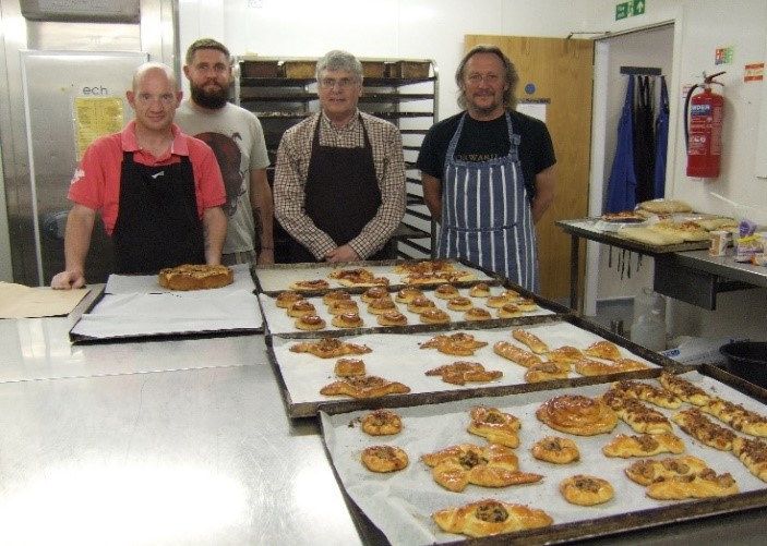 People baking food at the Church Homeless Trust,