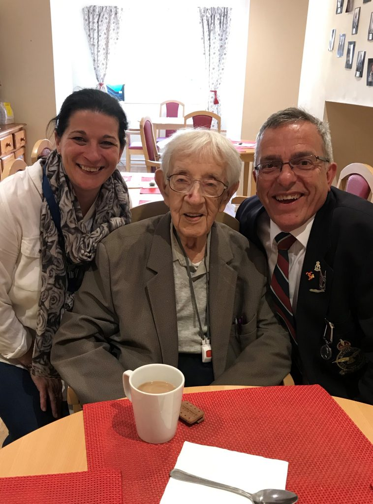 An older veteran enjoying an event with companions