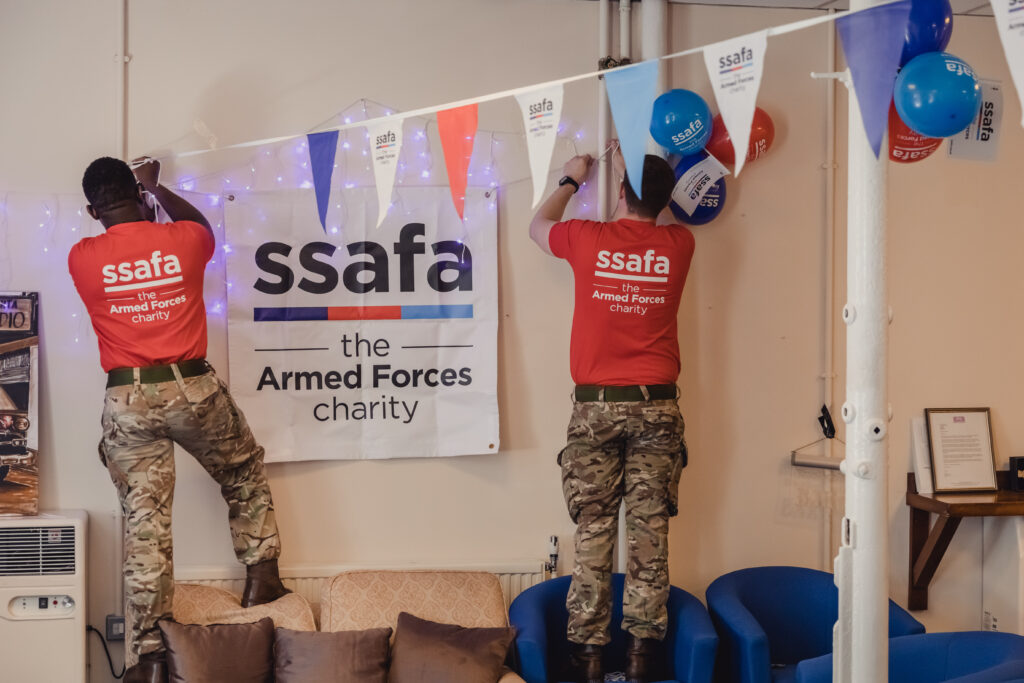 SSAFA supporters put up signs and bunting